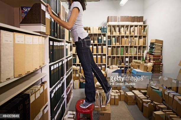 Mixed race student working in archive