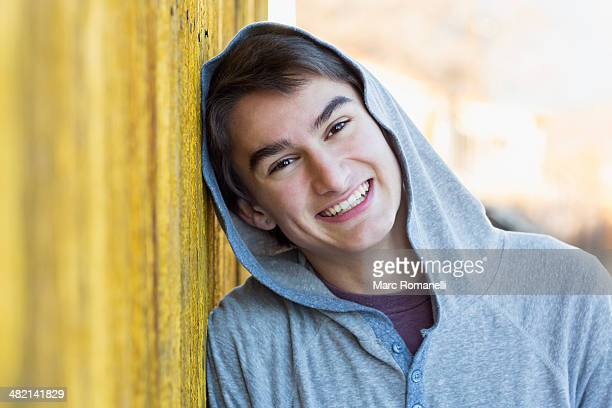 Mixed race teenage boy smiling