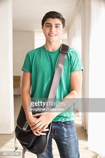 Mixed race teenage boy smiling