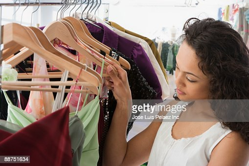 Similar images. Mixed Race Teenage Girl Choosing Prom Dress In Shop Stock Photo