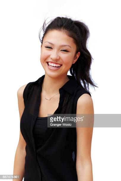 Mixed race teenage girl smiling