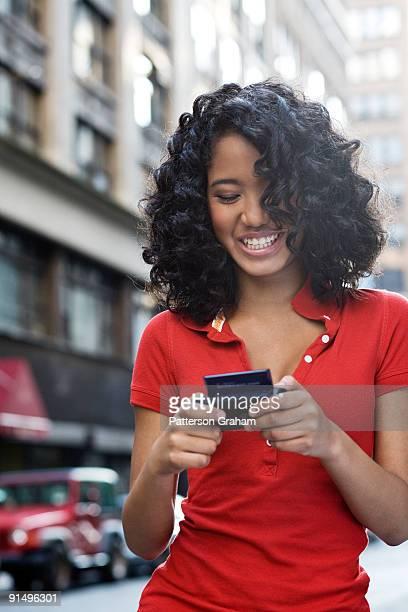 Mixed race teenage girl text messaging