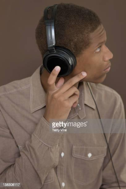 Mixed race teenager listening to headphones