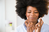 Mixed race woman crossing her fingers