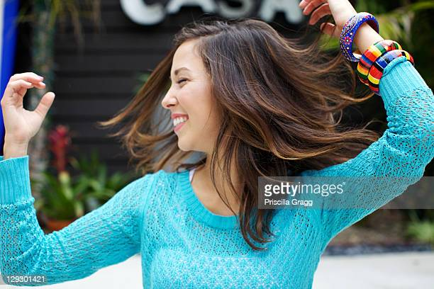 Mixed race woman dancing outdoors