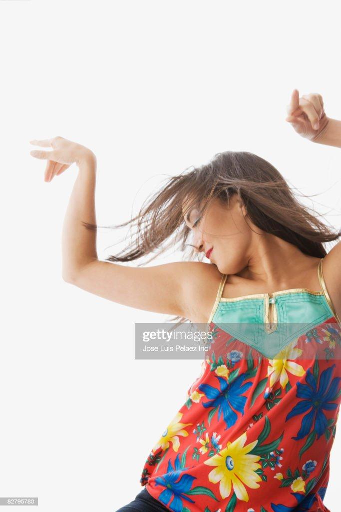 Mixed race woman dancing : Stock Photo