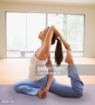 Mixed race woman doing yoga