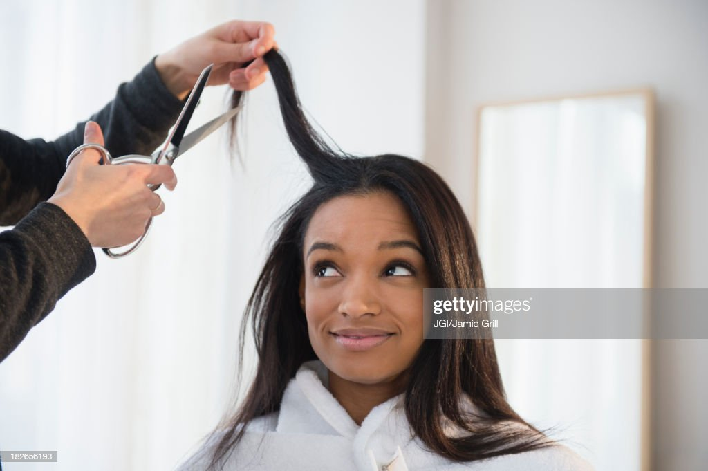 Mixed race woman getting hair cut