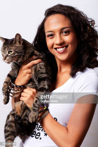 Mixed race woman holding cat