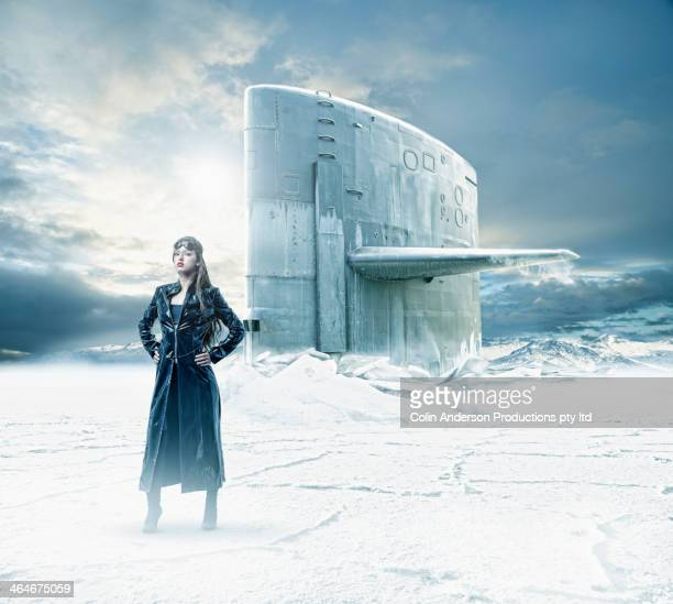 Mixed race woman on frozen landscape