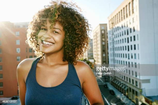 Mixed race woman on urban rooftop