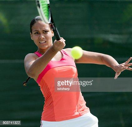 Mixed race Woman Playing Tennis