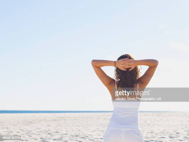 Mixed race woman relaxing on beach