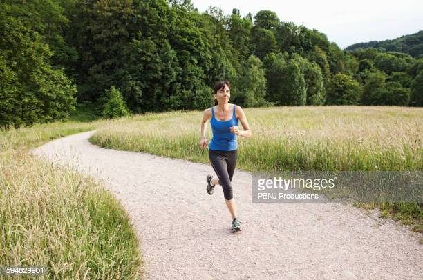 Mixed race woman running on path