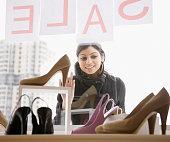 Mixed Race woman shoe shopping