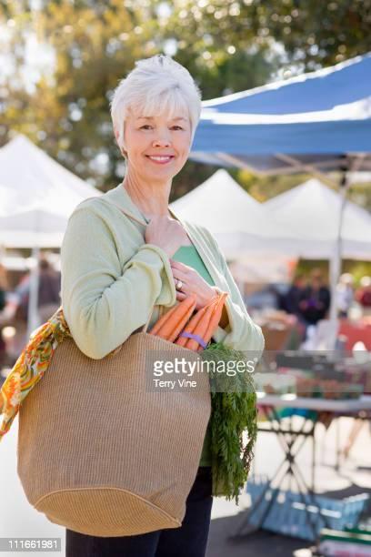 Mixed race woman shopping at farmer's market