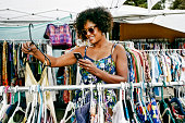 Mixed race woman shopping at flea market