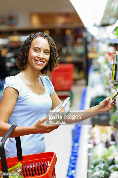 Mixed race woman shopping at supermarket