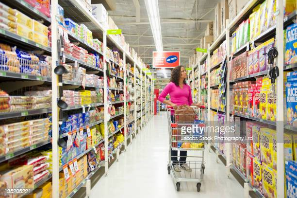 Mixed race woman shopping for groceries