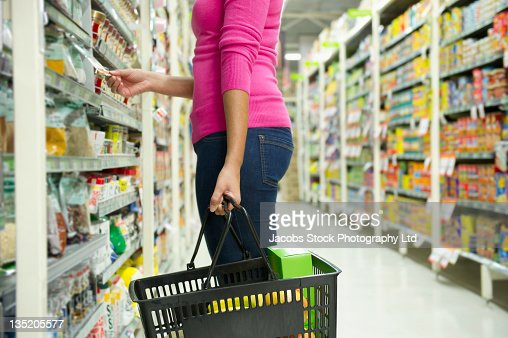 Mixed race woman shopping for groceries : Stock Photo