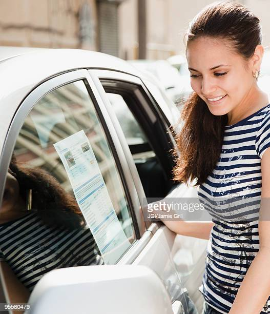 Mixed race woman shopping for new car