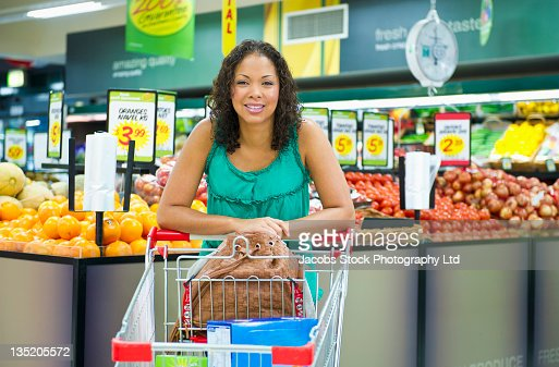 Mixed race woman shopping for vegetables : Stock Photo
