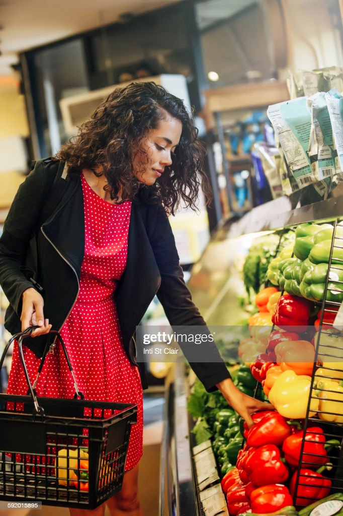 Mixed race woman shopping in grocery store