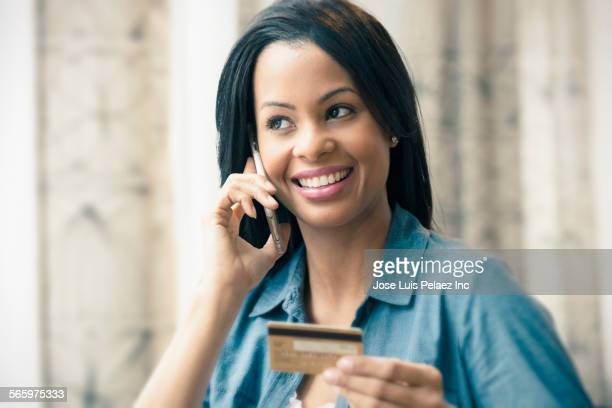 Mixed race woman shopping on cell phone