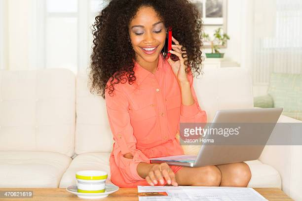 Mixed race woman shopping online