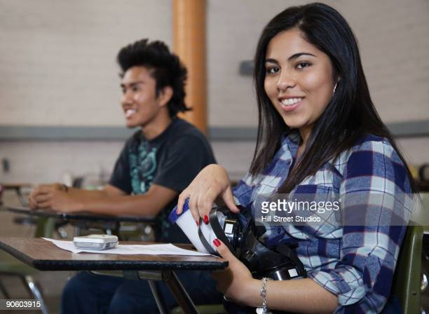 Mixed race woman smiling in classroom