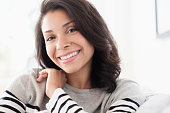 Mixed race woman smiling indoors