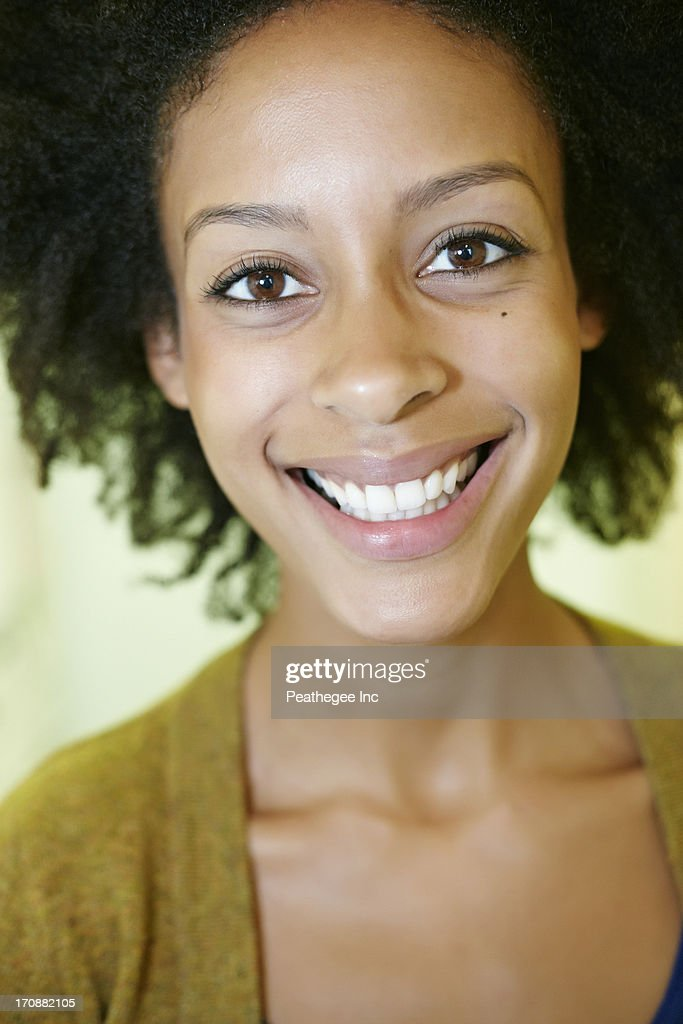 Mixed race woman smiling : Stock Photo