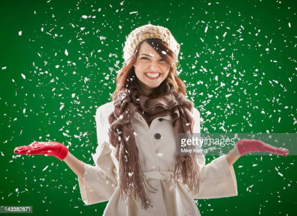 Mixed race woman standing in the snow