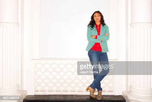 Mixed race woman standing on bench : Stock Photo