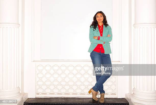 Mixed race woman standing on bench