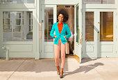 Mixed race woman standing on city sidewalk