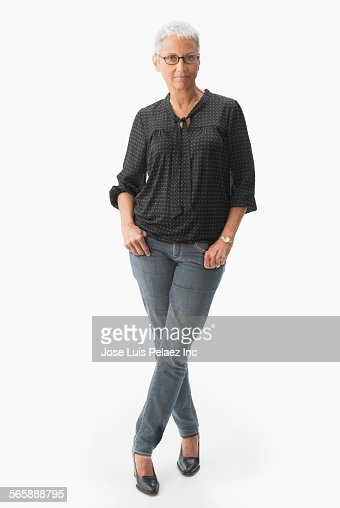 Mixed race woman standing with thumbs in pockets