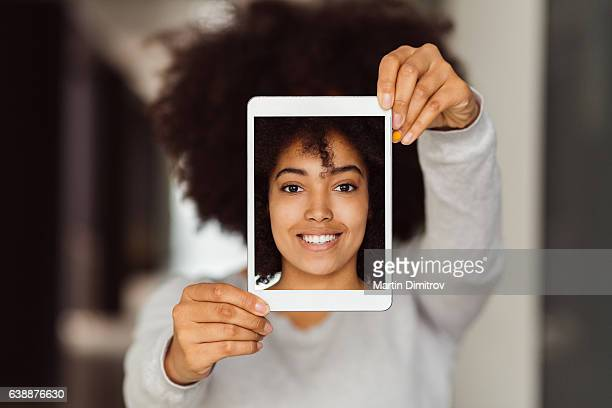 Mixed race woman taking selfie with tablet