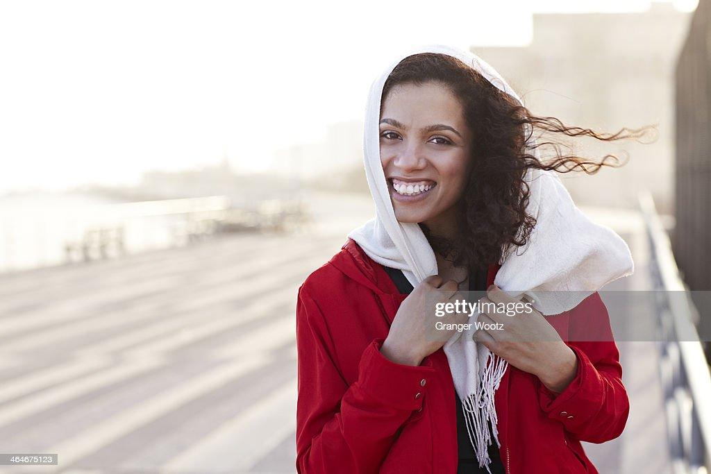 Mixed race woman walking on pier : Stock Photo