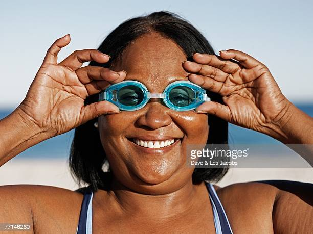 Mixed Race woman wearing swimming goggles