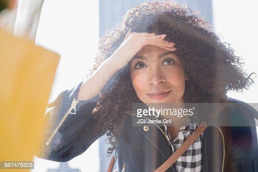 Mixed race woman window shopping