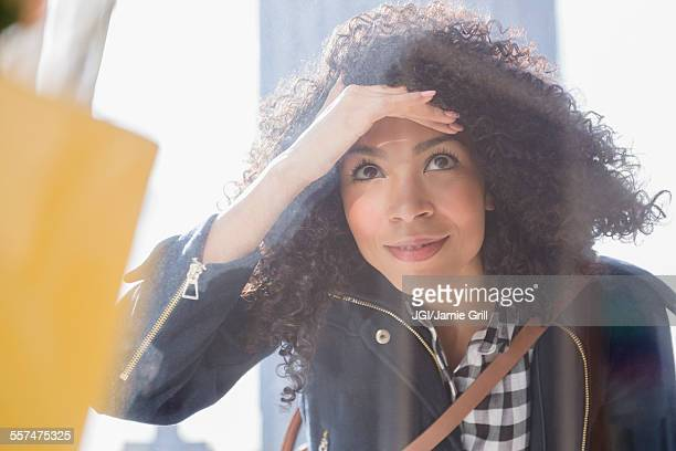 Mixed race woman window shopping