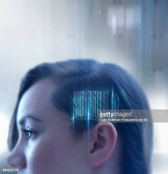 Mixed race woman with barcode in head