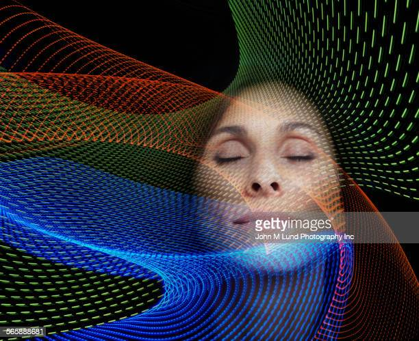 Mixed race woman with eyes closed in digital streams