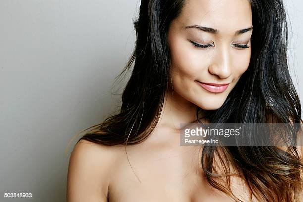 Mixed race woman with eyes closed
