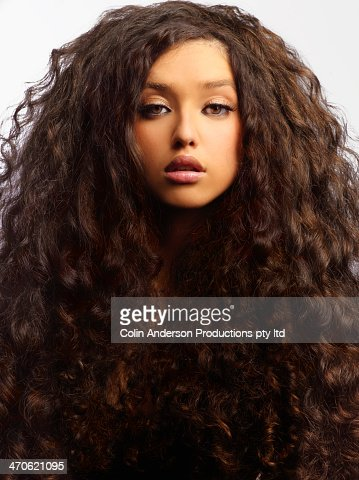 Mixed race woman with thick curly hair