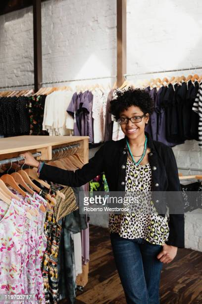 Mixed race woman working in clothing store