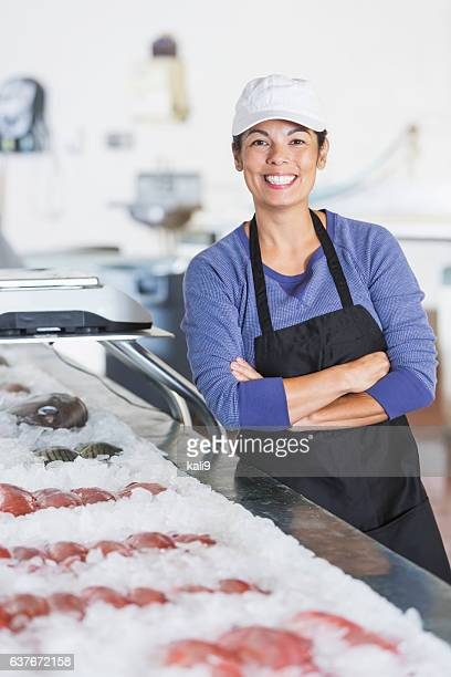 Mixed race woman working in fish market