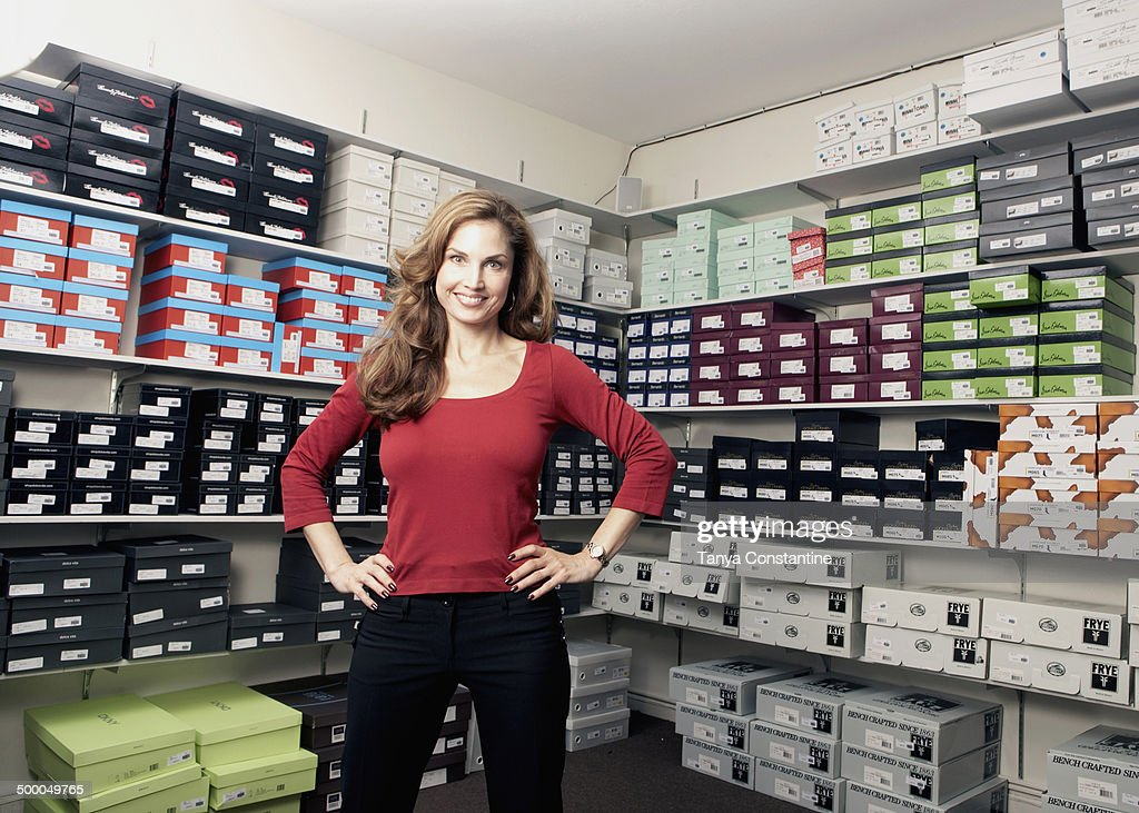 Mixed race woman working in shoe store : Stock Photo