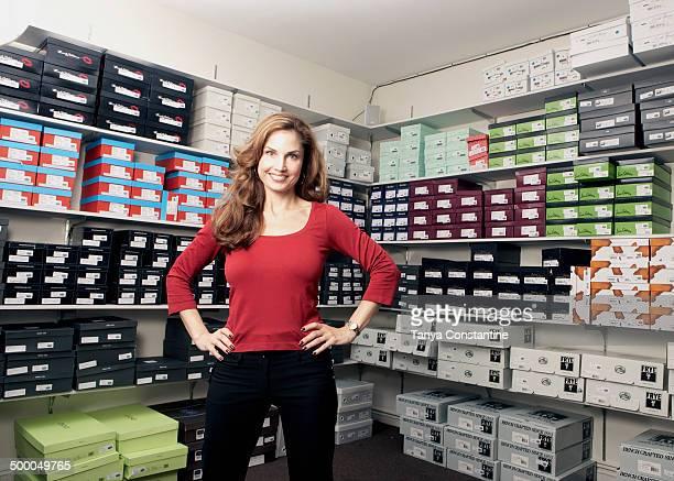 Mixed race woman working in shoe store